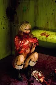 Zombie stripper 'Cat', (Jenna Jameson) savours the final remnants of her punter.